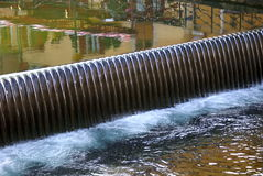 Weir in annecy france. Close up of water flowing over a wier in annecy france Stock Photos