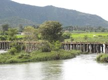 Weir and low head dam on river Kaveri with mountains on background. Weir, barrier and low head dam on river Kaveri with green mountains on background stock photography
