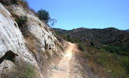Weir Canyon Trail. Sandstone geology on a hiking trail in Orange County, CA Royalty Free Stock Photo