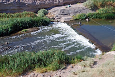 Weir on the Las Vegas Wash, Nevada. A weir is a barrier across a river designed to alter its flow characteristics and are commonly used to measure discharge stock image