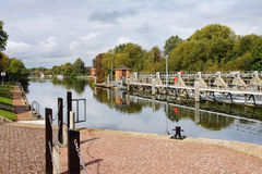 Weir and Lock on the River Thames. Weir and Lock entrance on the River Thames in England with moorings and footbridge royalty free stock images