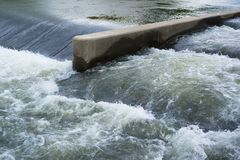 Weir. Is made of concrete. Flow of water a whitewater Royalty Free Stock Photos