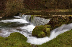 Weir near the Fish ponds, Lathkill Dale. Derbyshire. Lathkill Dale is a very popular destination in the peak district, for walking, trout fishing, Natural Stock Photos