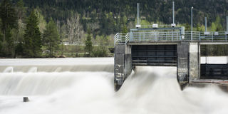 Weir plant with flowing water and trees in backgro Royalty Free Stock Photography