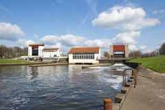 Weir with pumping station in dam Stock Photo