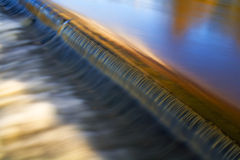 Weir on the River. Stock Images