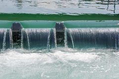 The weir in the river forms Small waterfall Stock Image