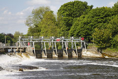 Weir on the River Thames. Flood waters passing through a Weir on the River Thames in England Royalty Free Stock Photo