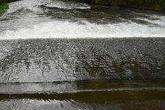 Weir on the River. Royalty Free Stock Image