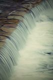 Weir. Some fast flow weir on the river, vertical Royalty Free Stock Photo