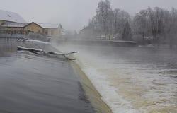 Weir in winter Stock Photo