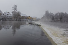 Weir in winter Stock Image
