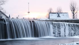 Weir in winter. Water falling down from the weir with some icicles in winter, Frydek-Mistek, Czech Republic stock images