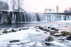 Weir in winter. Water falling down from the weir with some icicles in winter, Frydek-Mistek, Czech Republic stock photo
