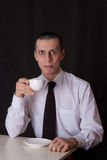 Weird businessman drinking coffee Stock Photo