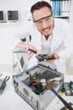 Weird computer engineer fixing broken cpu Royalty Free Stock Photo
