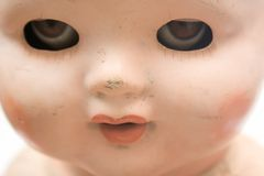 Weird Doll Face Stock Images