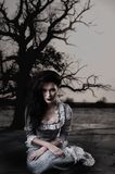 Weird female witch on background with dead tree Royalty Free Stock Photos