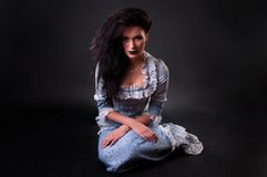 Weird female witch on black background Stock Photos