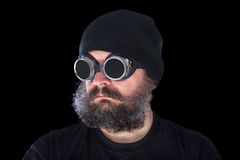 Weird guy with vintage welding goggles on black background Royalty Free Stock Image