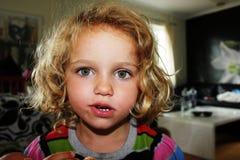 Weird looking girl. Little girl making a weird silly face Stock Image