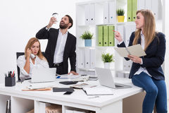Weird man with coffee in office Stock Photography