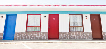 Motel with red and blue doors Royalty Free Stock Image
