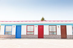 Motel with red and blue doors Stock Images