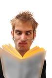 Weird nerd reading a book Stock Image