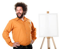 Weird painter in orange shirt. Guy in a bright, orange shirt, ready to paint, with a weird smile on his face Royalty Free Stock Images