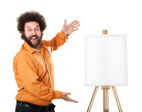 Weird painter in orange shirt. Guy in a bright, orange shirt, ready to paint, with a weird smile on his face Royalty Free Stock Photography