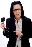 Weird Phone Call. Woman holding an old school phone pointing finger royalty free stock photo