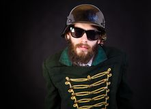 Weird portrait. Portrait of a strange man in hat and uniform Royalty Free Stock Photography