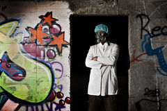 Weird Scientist. Standing at the entrance to a secret hiding place Stock Photography