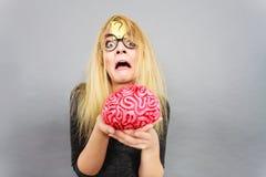 Weird woman holding brain having idea Royalty Free Stock Image