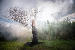 Weird woman in the morning mist Royalty Free Stock Photos