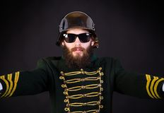 Weirdo. Hispter dressed as a military member but with sunglasses Royalty Free Stock Photo