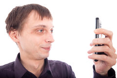 Weirdo man looking at cellphone. Isolated on white background Stock Photo