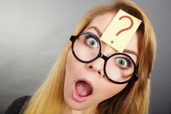 Weirdo nerd woman having question mark on forehead Stock Photo