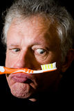 Weirdo with a toothbrush. Portrait of a man with toothbrush between lip and nose Stock Image