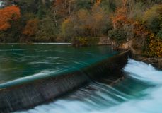 Weirs on river. In Fontaine-de-Vaucluse, France Stock Photos