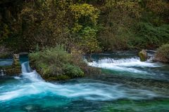 Weirs on river. In Fontaine-de-Vaucluse, France Stock Images