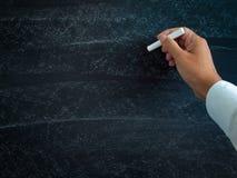 Weissen Sie auf einer Tafel, mit Mannhandschrift Stockbilder