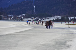 Weissensee in winter: hockey and ice skating Royalty Free Stock Photos