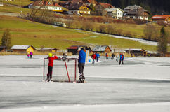 Weissensee in winter: hockey and ice skating Royalty Free Stock Photo