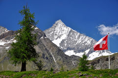 Weisshorn - Swiss alps. Beautiful mountain Weisshorn with Swiss flag - Swiss alps Stock Images