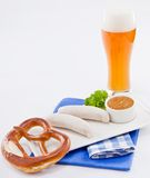 Weisswurst white sausages and sweet mustard with pretzel Royalty Free Stock Photo