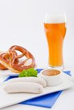 Weisswurst white sausages and sweet mustard with pretzel Stock Image