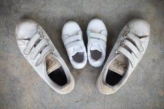 Weitere ` s Schuhe und Sohn ` s Schuhe Stockfotografie