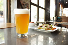 Weizen beer with bacon salad Royalty Free Stock Image